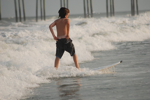 Surfing his shorts off