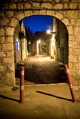 Through an arch and down another of Nachlaot's pretty lanes by Johnk85, on Flickr