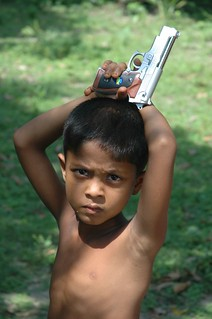 Little boy with toy gun