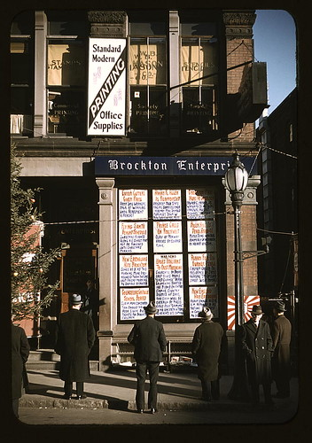 Men reading headlines posted in street-corner of Brockton Enterprise newspaper office, Brockton, Mass.  (LOC)