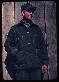 [Man in bill cap and dungaree coat, possibly a farmer] (LOC)