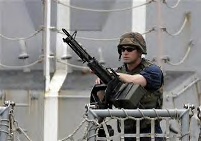 A U.S sailor stands on guard on the deck of the warship Bainbridge upon arrival at the port of Mombasa, Kenya, 500km from the capital Nairobi, April 16, 2009. by Pan-African News Wire File Photos