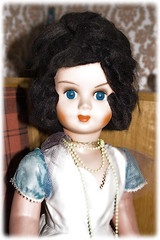 black hair, hairstyle, brown, clothing, head, hair, wig, blue, doll, eye, toy,