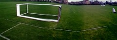 goalkeeper(0.0), tennis court(0.0), soccer-specific stadium(0.0), baseball field(0.0), player(0.0), lawn(0.0), flooring(0.0), sport venue(1.0), grass(1.0), artificial turf(1.0), net(1.0), goal(1.0),