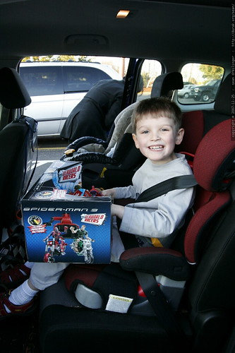 buckled in with the new toy in his lap    MG 6723