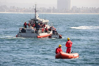 SAN DIEGO – U.S. Coast Guard crews and San Diego Lifeguards work together to recover simulated survivors during a mass rescue exercise near Mission Bay, March 5, 2014.  The exercise, sponsored by the San Diego Lifeguards, was designed to assess the participating agencies' ability to work together to respond to a major maritime disaster resulting in a large number of injured people in the water. U.S. Coast Guard photo by Petty Officer 3rd Class Connie Terrell.