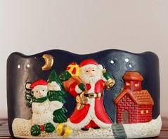 textile(0.0), stuffed toy(0.0), christmas decoration(1.0), santa claus(1.0), snowman(1.0), toy(1.0),