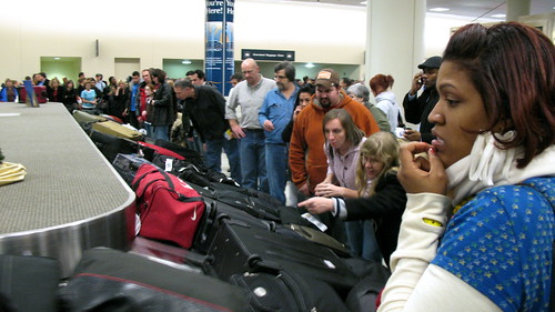 Passengers at an airport in Chicago look at a carousel with baggage from 25 delayed flights.