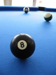 recreation(0.0), cue stick(0.0), carom billiards(0.0), english billiards(0.0), indoor games and sports(1.0), sports(1.0), nine-ball(1.0), pool(1.0), billiard table(1.0), games(1.0), billiard ball(1.0), eight ball(1.0), ball(1.0), cue sports(1.0),
