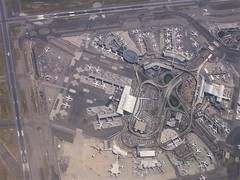 Flying over the airport before coming back around and landing on runway 13L