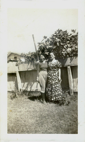 Two women and a fence