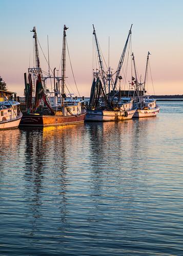 charleston shemcreek southcarolina boats fishing reflections sunset water mountpleasant unitedstates us