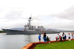 PEARL HARBOR (June 1, 2011) Family members and friends wave goodbye to Sailors manning the rails of guided-missile destroyer USS Chung Hoon (DDG 93) as it departs from Joint Base Pearl Harbor-Hickam. (U.S. Navy photo by Mass Communication Specialist 2nd Class Jon Dasbach/Released)