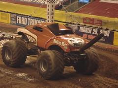 auto racing(0.0), stock car racing(0.0), dirt track racing(0.0), sprint car racing(0.0), screenshot(0.0), race track(0.0), automobile(1.0), racing(1.0), vehicle(1.0), sports(1.0), off road racing(1.0), motorsport(1.0), off-roading(1.0), rally raid(1.0), monster truck(1.0),