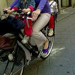 bicicletta ciclista con passeggeri
