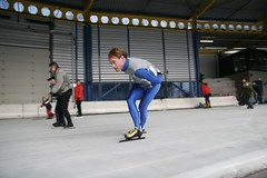 skating(1.0), winter sport(1.0), speed skating(1.0), sports(1.0), recreation(1.0), outdoor recreation(1.0), ice skating(1.0), ice rink(1.0),