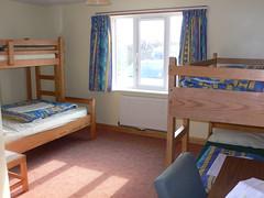 floor(1.0), building(1.0), furniture(1.0), room(1.0), property(1.0), bed(1.0), bedroom(1.0), dormitory(1.0),