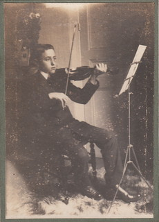 A French boy, 15 years old, playing a violin (6 October 1913)