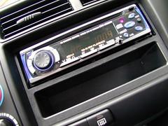 automotive exterior(0.0), steering wheel(0.0), vehicle audio(1.0), automobile(1.0), vehicle(1.0),