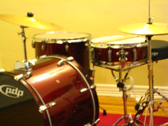 drummer(0.0), hand drum(0.0), tom-tom drum(1.0), percussion(1.0), bass drum(1.0), timbale(1.0), snare drum(1.0), drums(1.0), drum(1.0), timbales(1.0), skin-head percussion instrument(1.0),