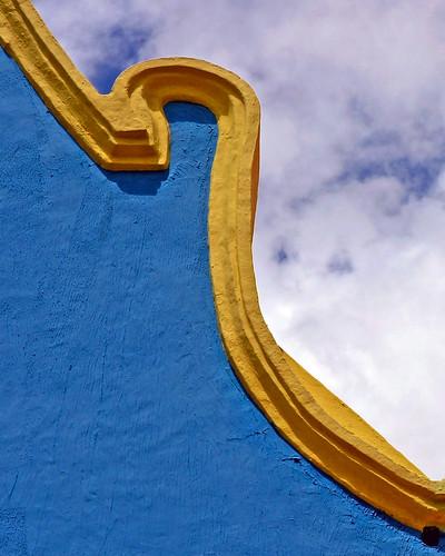 city blue sky house detail colors clouds island town unesco worldheritagesite curacao caribbean willemstad themoulinrouge dutchantilles mywinners anawesomeshot aplusphoto diamondclassphotographer superhearts theperfectphotographer platinumpeaceaward