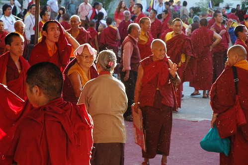 Tibetan Buddhists; Nuns, laypeople, monks greet each other, with fluff flying in the air, Tibetan religious community, Tharlam Monastery of Tibetan Buddhism, break, Sakya Lamdre, Boudha, Kathmandu, Nepal by Wonderlane