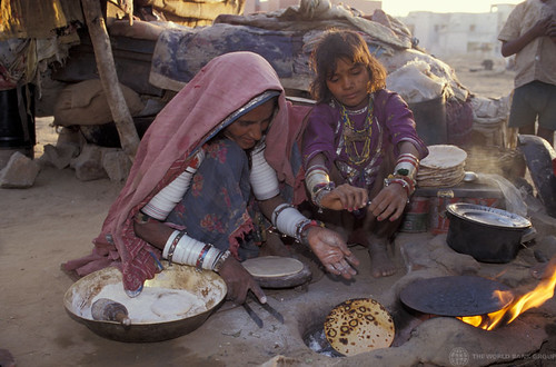 Migrant workers cook a meal
