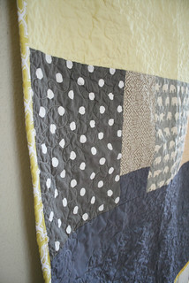 grey and yellow crib quilt