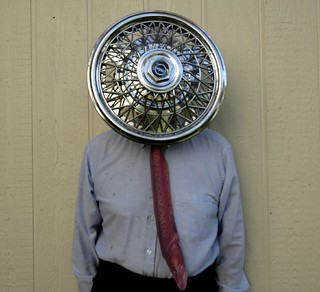 Self Portrait with Hubcap and Fish Tie