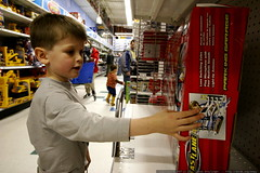 nick taking a closer look at a toy that caught his e…