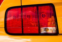 wheel(0.0), grille(0.0), vehicle registration plate(0.0), automobile(1.0), automotive tail & brake light(1.0), automotive exterior(1.0), yellow(1.0), automotive lighting(1.0), automotive design(1.0), light(1.0), bumper(1.0),