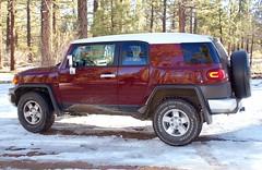 jeep wrangler(0.0), automobile(1.0), automotive exterior(1.0), sport utility vehicle(1.0), vehicle(1.0), toyota fj cruiser(1.0), compact sport utility vehicle(1.0), off-roading(1.0), off-road vehicle(1.0), bumper(1.0), land vehicle(1.0),