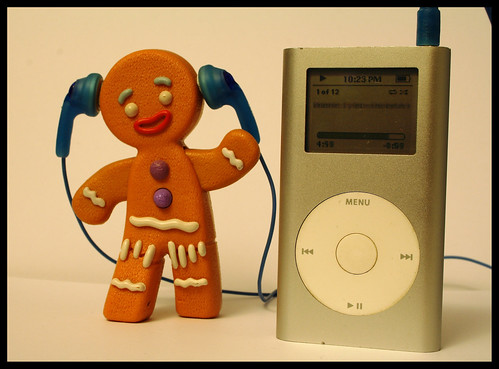 gingerbread man groving with a good old silver ipod mini