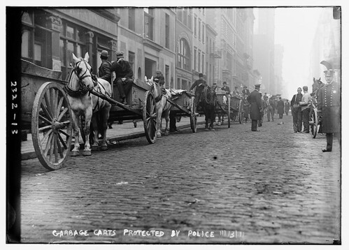 Garbage carts protected by police  (LOC)