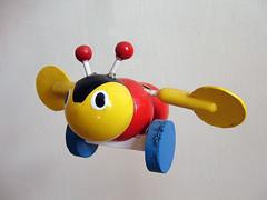 orange(0.0), textile(0.0), plush(0.0), stuffed toy(0.0), ball(0.0), baby toys(1.0), yellow(1.0), toy(1.0),
