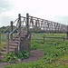 An Over-Elaborate Concrete & Metal Bridge Built To Cross Over A Fence When Surely A Simple Stile Would Have Done Nicely