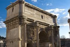 basilica(0.0), historic site(0.0), roman temple(0.0), ruins(0.0), ancient roman architecture(1.0), arch(1.0), ancient history(1.0), landmark(1.0), architecture(1.0), monument(1.0), facade(1.0), column(1.0), triumphal arch(1.0),