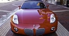 porsche cayman(0.0), automobile(1.0), vehicle(1.0), automotive design(1.0), pontiac solstice(1.0), land vehicle(1.0), luxury vehicle(1.0), sports car(1.0),