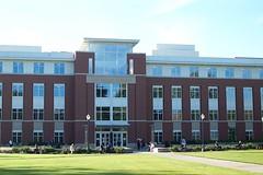 sport venue(0.0), headquarters(0.0), residential area(0.0), downtown(0.0), plaza(0.0), stadium(0.0), tower block(1.0), building(1.0), university(1.0), architecture(1.0), corporate headquarters(1.0), estate(1.0), facade(1.0), campus(1.0),