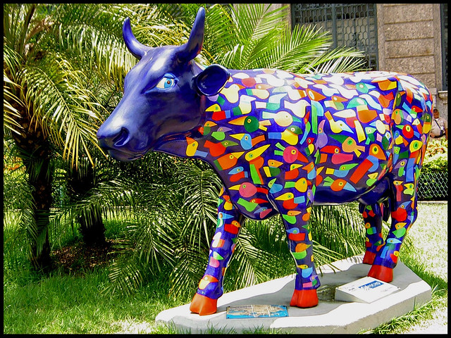 A Blue Cow With Toucans In Her Body...