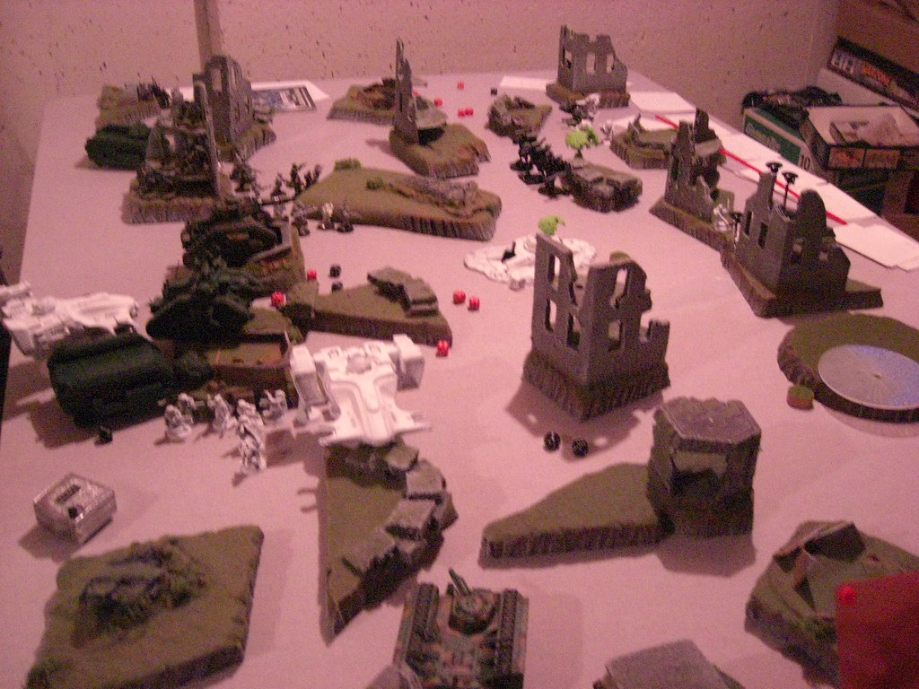 My Tau vs Dave's Imperial Guard -- Take and hold mission, the crash site in the middle.