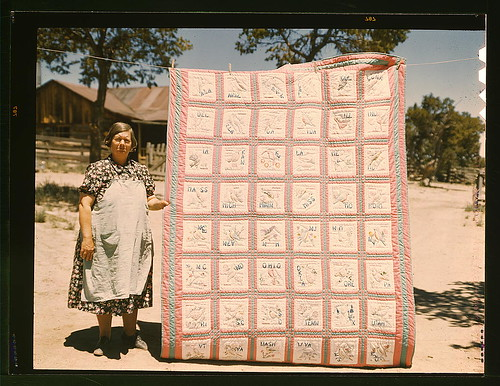 Mrs. Bill Stagg with state quilt that she made, Pie Town, New Mexico. A community settled by about 200 migrant Texas and Oklahoma farmers who filed homestead claims ... Mrs. Stagg helps her husband in the field with plowing planting, weeding corn and harv