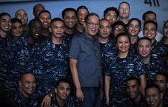 PACIFIC OCEAN (May 14, 2011) Republic of the Philippines President Benigno Aquino III poses for a photo with Sailors inside the hangar bay aboard the Nimitz-class aircraft carrier USS Carl Vinson (CVN 70). (U.S. Navy photo by Mass Communication Specialist 3rd Class Travis K. Mendoza)