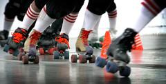 ice skating(0.0), football(0.0), skating(1.0), roller sport(1.0), footwear(1.0), sports(1.0), roller skates(1.0), roller skating(1.0),