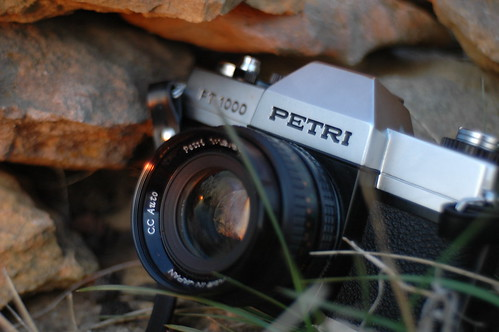 camera sunset orange black film horizontal closeup 35mm silver lens rocks petri carenar