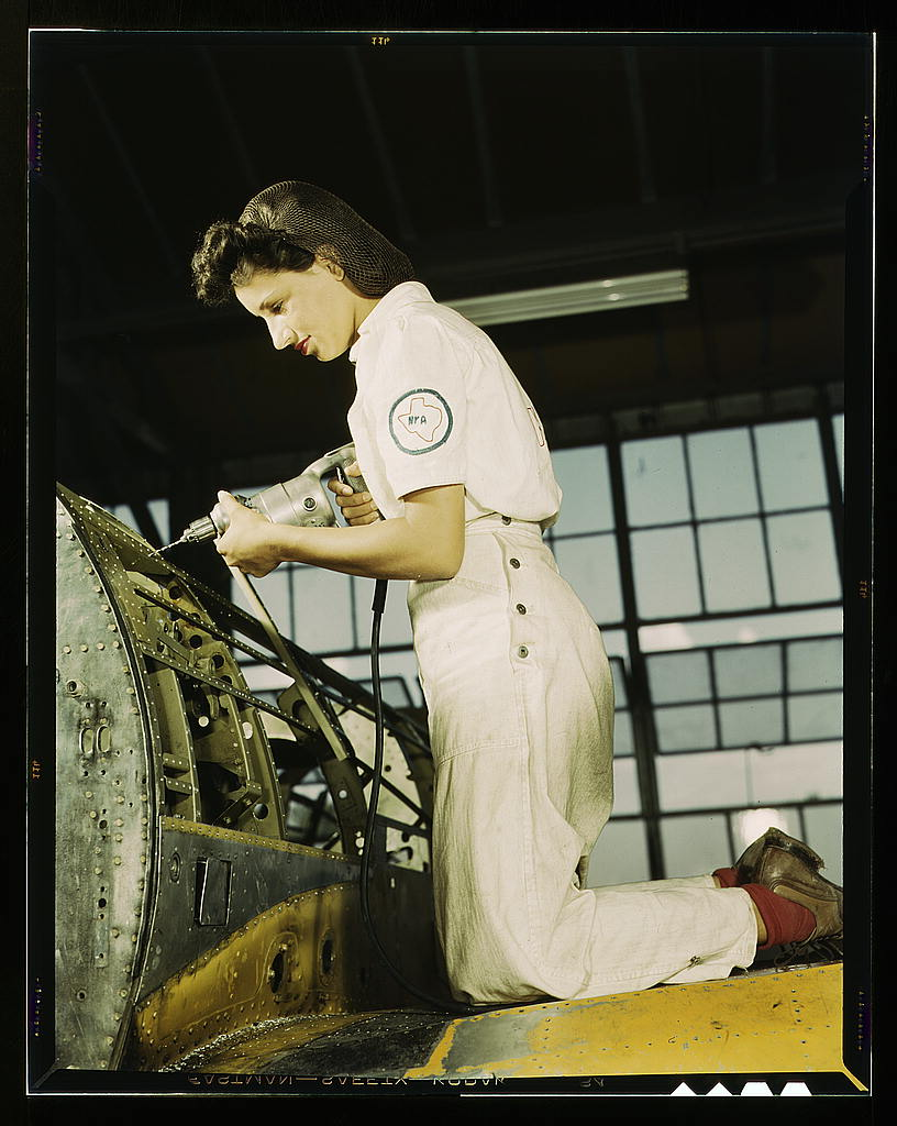 Oyida Peaks riveting as part of her NYA training to become a mechanic at the Naval Air Base, in the Assembly and Repair Department, Corpus Christi, Texas (LOC)