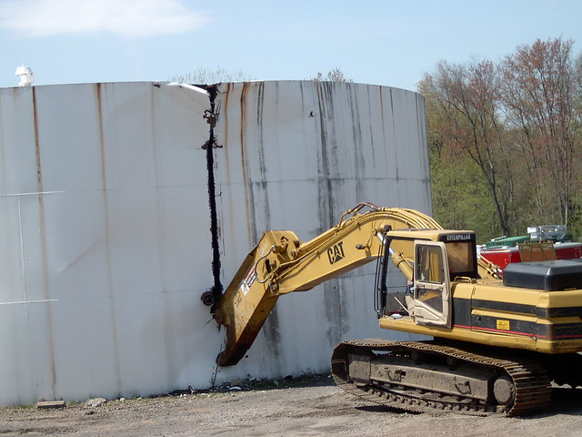 Oil Tank Demolition : Excavator with shear attachment cuts large tank flickr