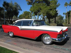 edsel ranger(0.0), edsel corsair(0.0), ford galaxie(0.0), convertible(0.0), automobile(1.0), automotive exterior(1.0), 1957 chevrolet(1.0), vehicle(1.0), full-size car(1.0), antique car(1.0), chevrolet bel air(1.0), sedan(1.0), land vehicle(1.0), luxury vehicle(1.0), coupã©(1.0),