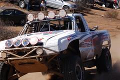 stock car racing(0.0), demolition derby(0.0), monster truck(0.0), auto racing(1.0), automobile(1.0), racing(1.0), vehicle(1.0), sports(1.0), race(1.0), dirt track racing(1.0), off road racing(1.0), motorsport(1.0), off-roading(1.0), rally raid(1.0), off-road vehicle(1.0),