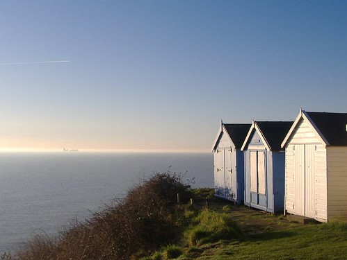 Cliff Top Beach Huts and Misty Contship by Lizziefrog